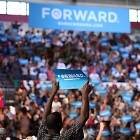 A supporter holds up a Forward sign prior to President Barack Obama speaking at his Grassroots event at the Kissimmee Civic Center in Kissimmee, Florida on Saturday, September 8, 2012. (AP Photo/Alex Menendez)