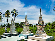 """19 JUNE 2016 - DON KHONE, CHAMPASAK, LAOS: People's graves, called """"chedis,"""" at Wat Khone Yai, a Buddhist temple in Don Khone village on Don Khone Island. Don Khone Island, one of the larger islands in the 4,000 Islands chain on the Mekong River in southern Laos. The island has become a backpacker hot spot, there are lots of guest houses and small restaurants on the north end of the island.      PHOTO BY JACK KURTZ"""
