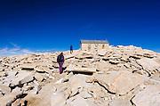 Hikers nearing the summit hut on Mount Whitney, Sequoia National Park, Sierra Nevada Mountains, California USA