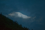 I got up before dawn to hike and saw the first light of day peak through the clouds and light up the snow covered peak.