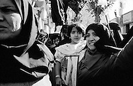 Iranian women and a child during a ceremony in honour of 65 martyrs of the Iran-Iraq war, whose bodies were recently discovered. Tehran, Iran, 2007
