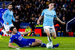 Phil Foden of Manchester City goes past Harry Maguire of Leicester City - Mandatory by-line: Robbie Stephenson/JMP - 18/12/2018 - FOOTBALL - King Power Stadium - Leicester, England - Leicester City v Manchester City - Carabao Cup Quarter Finals