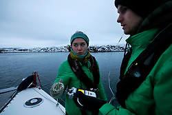NORWAY TROMSO 5DEC15 - Greenpeace campaigners Larissa Baeumer of Germany and Erlend Tellnes of Norway listen to a hydrophone during whale observations in Kvalsoya Sound near the arctic city of Tromso.<br /> <br /> jre/Photo by Jiri Rezac / Greenpeace<br /> <br /> © Jiri Rezac 2015
