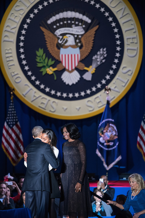 President Obama gives Malia Obama a hug following his farewell speech at McCormick Place on January 10, 2017.