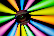 A pierced uvula is surrounded by neon-colorful bars.Black light
