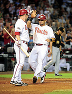 Sep. 20 2011; Phoenix, AZ, USA; Arizona Diamondbacks infielder .Aaron Hill (2) congratulates teammate outfielder Gerardo Parra (8) as he crosses home plate during the seventh  inning against the Pittsburgh Pirates at Chase Field. Mandatory Credit: Jennifer Stewart-US PRESSWIRE