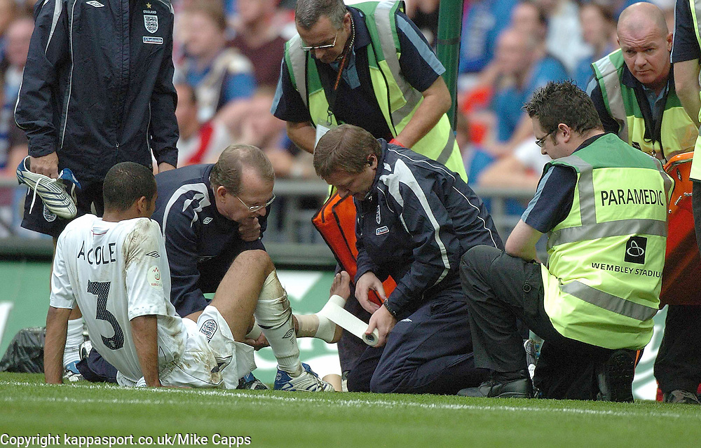 ENGLANDS ASHLEY COLE, lays injured after his tackle on goal, England - Estonia, UEFA European Championships 2008, Wembley, 13/10/2007