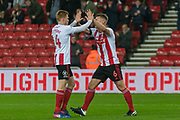 Duncan Watmore of Sunderland FC and Max Power of Sunderland FC celebrating their team's first goal during the EFL Sky Bet League 1 match between Sunderland and Burton Albion at the Stadium Of Light, Sunderland, England on 26 November 2019.