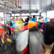 Skiers exit the tram.