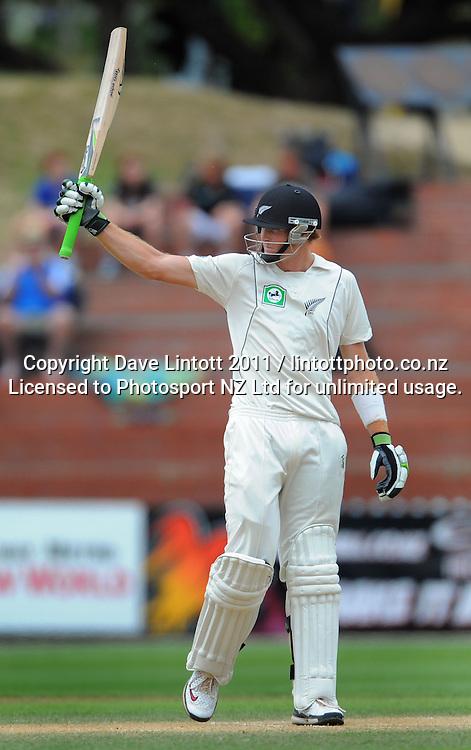 NZ batsman Martin Guptill celebrates his 50 runs. 2nd cricket test match - New Zealand Black Caps v Pakistan, day four at the Basin Reserve, Wellington, New Zealand on Tuesday, 18 January 2011. Photo: Dave Lintott / photosport.co.nz