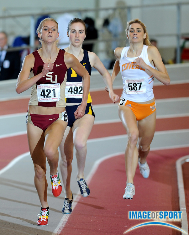 Mar 15, 2008; Fayetteville, AR, USA; Hannah England of Florida State (421) outsprints Nicole Edwards of Michgan (492), center and Sarah Bowman of Tennessee (587) to win the women's mile in 4:35.30 in the NCAA indoor track and field championships at the Randal Tyson Center. Edwards was second in 4:35.74 and Bowman was third in 4:36.00.