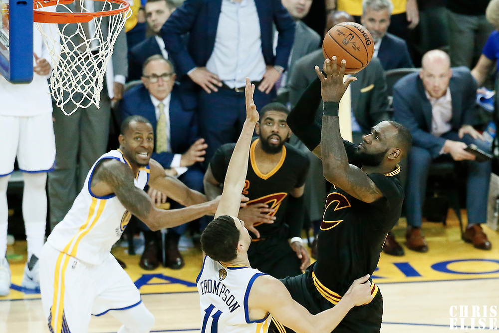 12 June 2017: Cleveland Cavaliers forward LeBron James (23) goes for the layup past Golden State Warriors guard Klay Thompson (11) during the Golden State Warriors 129-120 victory over the Cleveland Cavaliers, in game 5 of the 2017 NBA Finals, at the Oracle Arena, Oakland, California, USA.