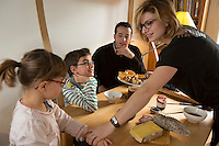Chef Sylvain Sendra at home with his wife, Sarah, and children Clara and Alexis, taking a break from his Paris Restaurant, L'Itineraire - <br /> <br /> <br /> <br /> Sarah is the Director of the restaurant and so is happy to take a break to be with the family as well.<br /> <br /> January 3, 2014<br /> <br /> Photograph by Owen Franken for the NY Times