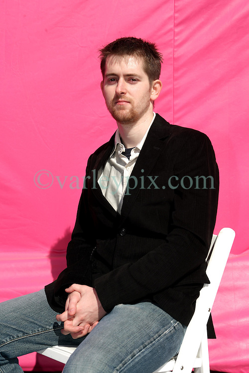 Dec 03 2007. New Orleans, Louisiana. Lower 9th Ward.<br /> Brad Pitt revisits the Lower 9th ward, devastated by Hurricane Katrina to present 'Make it Right' where architects' designs are unveiled to the public. One of the winning design Architects, Chad Kraus of Shigeru Ban of Japan with a pink background for the pink project.<br /> Photo credit; Charlie Varley.