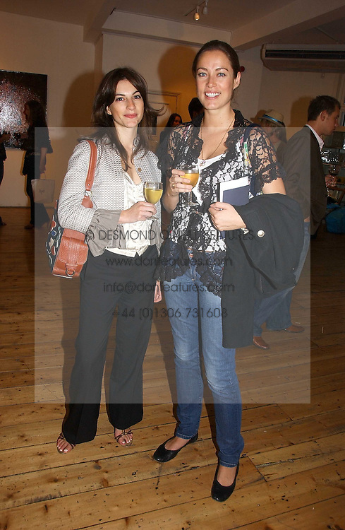 Left to right, ALI HILLMAN and CRESSIDA WILSON at a private view of artist Adam Bricusse's paintings entitles 'The Mysteries Within' held at the Charing X Gallery, 121-125 Charing Cross Road, London WC2 on 12th September 2006.<br /><br />NON EXCLUSIVE - WORLD RIGHTS