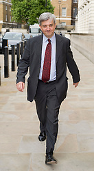 © licensed to London News Pictures. File picture dated. 23/05/2011. London, UK. Essex Police have interviewed Lib Dem Cabinet minister Chris Huhne over allegations he tried to evade punishment for speeding. The police are investigating claims Mr Huhne asked someone to take his penalty points for a 2003 speeding offence. Pictured leaving the Department For Enargy And Climate Change (23/05/2011). Photo credit should read: Ben Cawthra/LNP