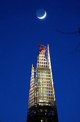 © Licensed to London News Pictures. 02/02/2014. London, UK Europe's tallest building, The Shard, reaches for the crescent moon just after sunset on 2nd February 2014 in central London. Photo credit : Natalie Whynot/LNP