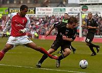Photo: Glyn Thomas.<br />Rotherham United v Brentford. Coca Cola League 1. 15/04/2006.<br />Rotherham's Lee Williamson (L) and Brentford's Jay Tabb battle.