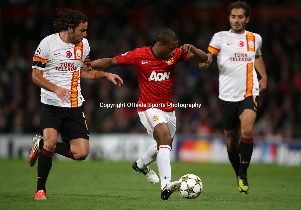 19th September 2012 - UEFA Champions League (Group H) - Manchester United vs. Galatasaray - Patrice Evra of Man Utd battles with Selcuk Inan of Galatasaray (L) and Hamit Altintop of Galatasaray - Photo: Simon Stacpoole / Offside.