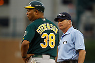 May 31, 2010: Oakland Athletics'First Base Coach Todd Steverson and umpire John Hirschbeck during the MLB baseball game between the Oakland Athletics and Detroit Tigers at  Comerica Park in Detroit, Michigan. Oakland defeated Detroit 4-1.