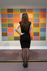 © Licensed to London News Pictures. 08/11/2013. London, UK. A Sotheby's employee stands in front of 'Untitled (10/69)' (1969) (est. GB£10,000-15,000) by British abstract artist Jeremy Moon, one of 285 pieces of art that make up Sotheby's latest sale 'Defining Taste' at the London based auction houses New Bond Street premises. The auction, set to take place on the 12th of November 2013, consists of art, ranging in price from GB£100-120,000 and from the middle ages to very present works, that were collected during the 45 year career of esteemed art dealer Danny Katz. Photo credit: Matt Cetti-Roberts/LNP