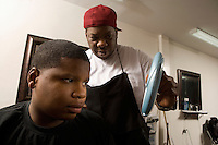 Boy being shown his shaven head in the barbers