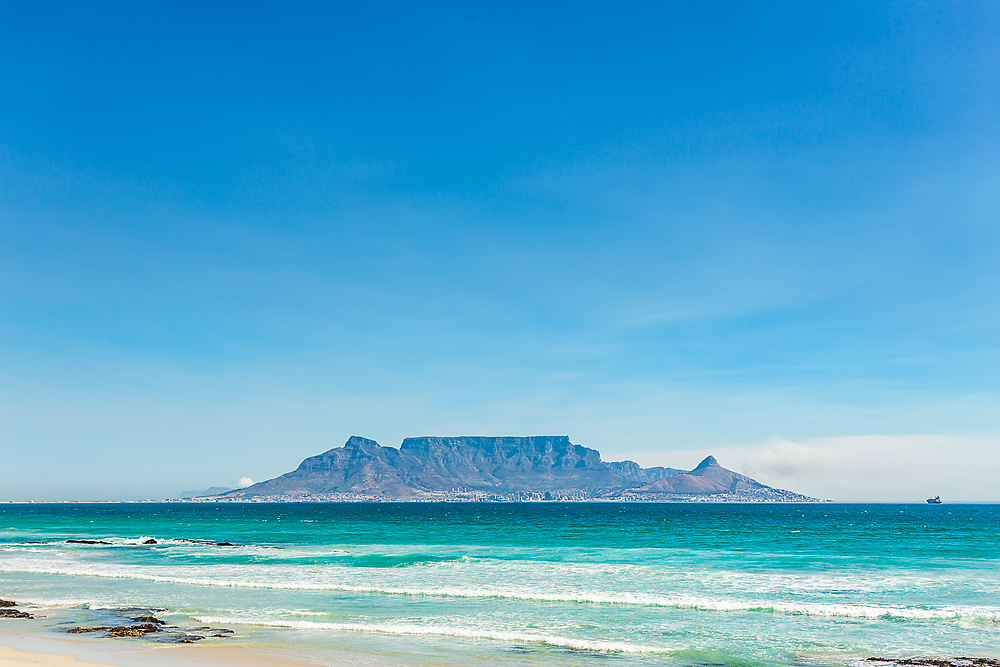 Table Mountain view from Bloubergstrand Beach in Cape Town, South Africa.