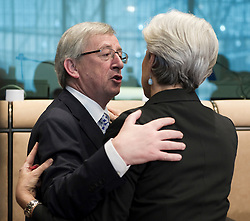Jean-Claude Juncker, Luxembourg's prime minister, and president of the Eurogroup, left, greets Christine Lagarde, France's finance minister, during an emergency meeting of euro zone finance ministers in Brussels, on Sunday, May 2, 2010. Greece accepted an unprecedented bailout from the European Union and International Monetary Fund worth more than 110 billion euros ($146 billion). (Photo © Jock Fistick)