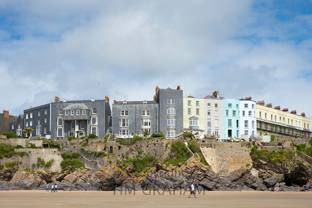 Esplanade - traditional brightly coloured seaside housing, hotels and tourist accommodation above clifftop in resort town of Tenby, Wales, UK
