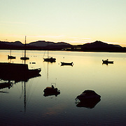 Sunrise at Roundstone fishing villiage. Connemara, County Galway, Ireland lies on the western arm of Bertraghboy Bay 48 miles (77km) north-west of Galway city. The Connemara village is beautifully set on one of the most spectacular coastal drives in Ireland overlooking the Atlantic at the foot of Errisbeg Mountain. Roundstone, Connemara, County Galway. Ireland. 23rd July 2011. Photo Tim Clayton