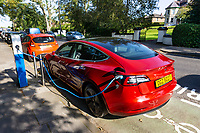 """Tesla automobile, car, """"refuels"""" at a public charging point in Hillsborough, Co Down, N Ireland, UK, 16th November 2019, 201909211571<br /><br />Copyright Image from Victor Patterson, Belfast, UK<br /><br />t: +44 28 9066 1296 (from Rep of Ireland 048 9066 1296)<br />m: +44 7802 353836<br /><br />victorpattersonbelfast@gmail.com<br />www.victorpatterson.com<br /><br />Please see my Terms and Conditions of Use at https://www.victorpatterson.com/page2<br />It is IMPORTANT that you familiarise yourself with them.<br /><br />Images used online incur an additional cost and must be visibly watermarked i.e. © Victor Patterson within the body of the image and copyright metadata must not be deleted. Images used on the Internet have a size restriction of 4kbs and are chargeable at rates available at victorpatterson.com.<br /><br />This image is only available for the use of the download recipient i.e. television station, newspaper, magazine, book publisher, etc, and must not be passed on to any third party. It is also downloaded on condition that each and every subsequent usage is notified within 7 days to victorpattersonbelfast@gmail.com<br /><br />The right of Victor Patterson to be identified as the author is asserted in accordance with The Copyright Designs And Patents Act (1988). All moral rights are asserted."""