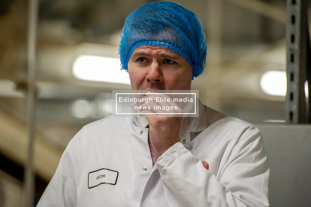 Pictured: Derek Mackay<br /> Economy Secretary Derek Mackay visited Nairn's Oatcakes in Edinburgh today to comment on the latest export and GDP statistics. Mr Mackay enjoyed a short tour of the factory where staff demonstrated the manufacturing process.<br /> <br /> Ger Harley   EEm 30 January 2019