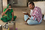 Vishram Bhai and his wife, Vasanben, drinking chai at their home in Ahmedabad, India.