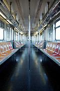 The empty interior of a New York City subway car.