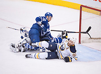 March 19, 2016:  Buffalo Sabres Center Ryan O'Reilly (90) [7452] falls over Josh Leivo in the third period of game between the Buffalo Sabres and the Toronto Maple Leafs at the Air Canada Centre in Toronto, ON, Canada. (Photo by Peter Llewellyn/ Icon Sportswire)