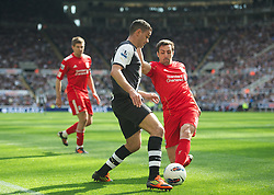 NEWCASTLE-UPON-TYNE, ENGLAND - Sunday, April 1, 2012: Liverpool's Jose Enrique in action against Newcastle United's Hatem Ben Arfa during the Premiership match at St James' Park. (Pic by David Rawcliffe/Propaganda)
