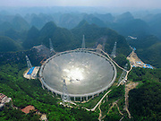 PINGTANG, CHINA - MAY 07: (CHINA OUT) <br /> <br /> Aerial view of the construction site of a Five-hundred-meter Aperture Spherical Telescope (FAST) on May 7, 2016 in Pingtang County, Guizhou Province of China. The dish-like telescope, as large as 30 football fields, will be completed in September 2016. <br /> ©Exclusivepix Media