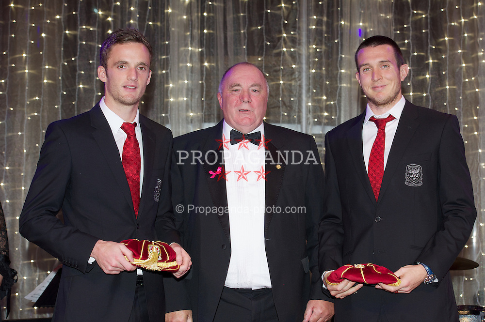 CARDIFF, WALES - Monday, October 8, 2012: Wales' FAW President Trevor Lloyd-Hughes presents caps to Andy King [l] and goalkeeper Lewis Price [r] during the FAW Player of the Year Awards Dinner at the National Museum Cardiff. (Pic by David Rawcliffe/Propaganda)