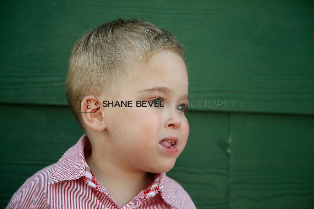 5/28/15 5:28:39 PM -- Miracle Miles and his family pose for portraits and play at the QuikTrip park for the 2015 Saint Francis Health System advertising campaign. <br /> <br /> Photo by Shane Bevel