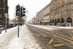 The Beast from the East, Storm Emma hit Edinburgh overnight and has left transport links decimated and many of the shops on the famous Princes Street closed for the day.<br /> <br /> Pictured: A deserted Princes Street with buses and trams all cancelled.