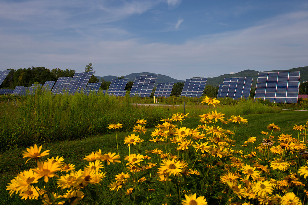 As shown on Aug. 17, 2017 in Rutland, Vt., three solar projects have been installed near the Rutland Community Garden's 50 plots, within view of the Green Mountains and Killington Peak, the second highest in Vermont. According to Green Mountain Power, Rutland is the Solar Capital of New England, with the most solar per capita of any city in the region. (Photo by Geoff Hansen)