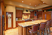 Contemporary kitchen counter with chair in luxury manor house