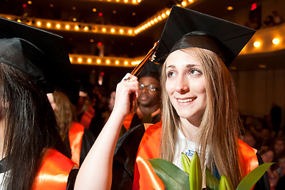 Lathan Goumas | MLive.com..Valedictorian Elizabeth Gellis, 18, prepares to turn her tassel during the 2012 Flushing High School commencement ceremony at the Whiting Theater in Flint, Mich. on Sunday June 3, 2012.