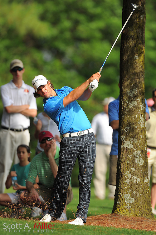 Aaron Baddeley hits from the rough during the third round of the Wells Fargo Championship at the Quail Hollow Club on May 5, 2012 in Charlotte, N.C. ..©2012 Scott A. Miller.