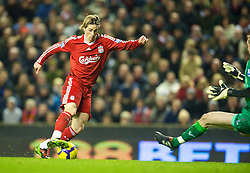 LIVERPOOL, ENGLAND - Wednesday, December 16, 2009: Liverpool's Fernando Torres, making his 100th appearance in a Red shirt, on his way to scoring the second goal of the game against Wigan Athletic, his 49th goal for Liverpool, during the Premiership match at Anfield. (Photo by: David Rawcliffe/Propaganda)