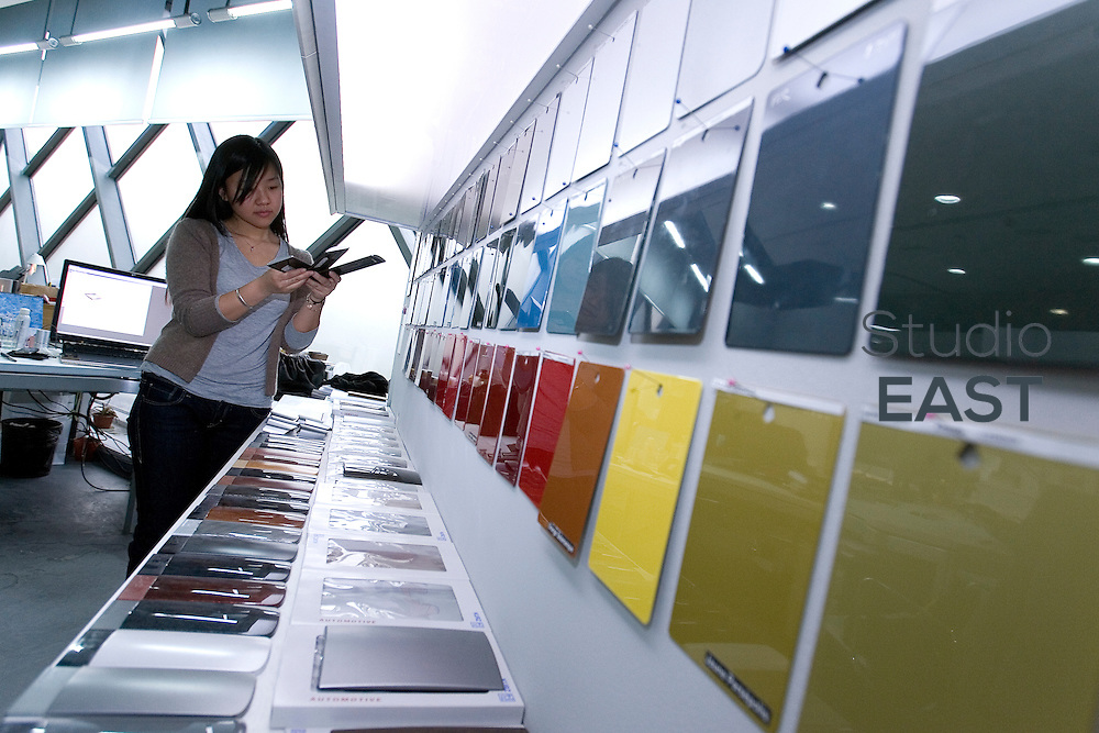 Peugeot Senior Color and Trim Designer Jojo Zhu chooses between samples of colors in PSA Peugeot Citroen China Tech Center in the outskirts of Shanghai, China, on April 9, 2010. Photo by Lucas Schifres/Pictobank