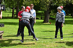 August 17, 2017 - Wales, Wales, United Kingdom - Image ©Licensed to i-Images Picture Agency. 17/08/2017. Wales, United Kingdom. Theresa May visits Wales. The British  Prime Minister Theresa May  visit's Woodland Outdoor  Education Centre in Glasbury-on-Wye, Wales,  meeting young people taking part in outdoor training and staff working at the centre.  Picture by Andrew Parsons / i-Images (Credit Image: © Andrew Parsons/i-Images via ZUMA Press)