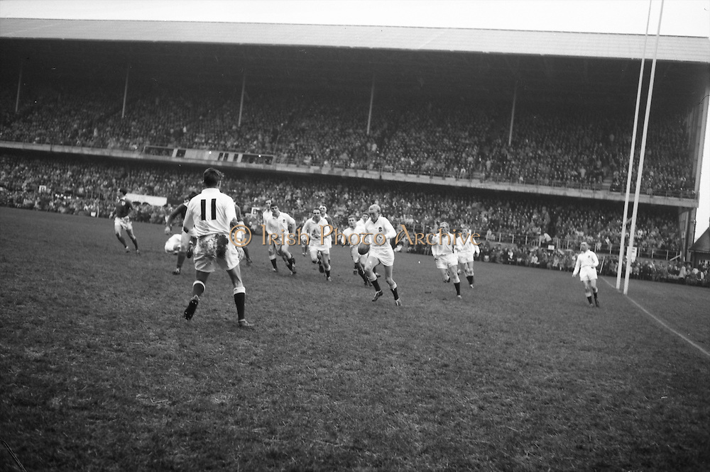 Sharp, English captain, leads his men as he kicks for touch,..Irish Rugby Football Union, Ireland v England, Five Nations, Landsdowne Road, Dublin, Ireland, Saturday 9th February, 1963,.9.2.1963, 2.9.1963,..Referee- H B Laidlaw, Scottish Rugby Union, ..Score- Ireland 0 - 0 England, ..Irish Team, ..B D E Marshall, Wearing number 15 Irish jersey, Full Back, Queens University Rugby Football Club, Belfast, Northern Ireland,..W R Hunter, Wearing number 14 Irish jersey, Right Wing, C I Y M S Rugby Football Club, Belfast, Northern Ireland, ..J C Walsh,  Wearing number 13 Irish jersey, Right Centre, University college Cork Football Club, Cork, Ireland,..P J Casey, Wearing number 12 Irish jersey, Left Centre, University College Dublin Rugby Football Club, Dublin, Ireland, ..N H Brophy, Wearing number 11 Irish jersey, Left wing, Blackrock College Rugby Football Club, Dublin, Ireland, ..M A English, Wearing number 10 Irish jersey, Stand Off, Landsdowne Rugby Football Club, Dublin, Ireland, ..J C Kelly, Wearing number 9 Irish jersey, Scrum Half, University College Dublin Rugby Football Club, Dublin, Ireland,..R J McLoughlin, Wearing number 1 Irish jersey, Forward, Blackrock College Rugby Football Club, Dublin, Ireland, ..A R Dawson, Wearing number 2 Irish jersey, Forward, Wanderers Rugby Football Club, Dublin, Ireland, ..S Millar, Wearing number 3 Irish jersey, Forward, Ballymena Rugby Football Club, Antrim, Northern Ireland,..W A Mulcahy, Wearing number 5 Irish jersey, Captain of the Irish team, Forward, Bective Rangers Rugby Football Club, Dublin, Ireland,  ..W J McBride, Wearing number 5 Irish jersey, Forward, Ballymena Rugby Football Club, Antrim, Northern Ireland,..E P McGuire, Wearing number 6 Irish jersey, Forward, University college Galway Football Club, Galway, Ireland,..C J Dick, Wearing number 8 Irish jersey, Forward, Ballymena Rugby Football Club, Antrim, Northern Ireland,..M D Kiely, Wearing number 7 Irish jersey, Forward, Landsdowne Rugby Football Club, Dublin, Ir