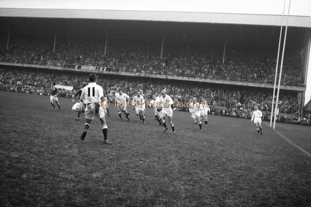 Sharp, English captain, leads his men as he kicks for touch,..Irish Rugby Football Union, Ireland v England, Five Nations, Landsdowne Road, Dublin, Ireland, Saturday 9th February, 1963,.9.2.1963, 2.9.1963,..Referee- H B Laidlaw, Scottish Rugby Union, ..Score- Ireland 0 - 0 England, ..Irish Team, ..B D E Marshall, Wearing number 15 Irish jersey, Full Back, Queens University Rugby Football Club, Belfast, Northern Ireland,..W R Hunter, Wearing number 14 Irish jersey, Right Wing, C I Y M S Rugby Football Club, Belfast, Northern Ireland, ..J C Walsh,  Wearing number 13 Irish jersey, Right Centre, University college Cork Football Club, Cork, Ireland,..P J Casey, Wearing number 12 Irish jersey, Left Centre, University College Dublin Rugby Football Club, Dublin, Ireland, ..N H Brophy, Wearing number 11 Irish jersey, Left wing, Blackrock College Rugby Football Club, Dublin, Ireland, ..M A English, Wearing number 10 Irish jersey, Stand Off, Landsdowne Rugby Football Club, Dublin, Ireland, ..J C Kelly, Wearing number 9 Irish jersey, Scrum Half, University College Dublin Rugby Football Club, Dublin, Ireland,..R J McLoughlin, Wearing number 1 Irish jersey, Forward, Blackrock College Rugby Football Club, Dublin, Ireland, ..A R Dawson, Wearing number 2 Irish jersey, Forward, Wanderers Rugby Football Club, Dublin, Ireland, ..S Millar, Wearing number 3 Irish jersey, Forward, Ballymena Rugby Football Club, Antrim, Northern Ireland,..W A Mulcahy, Wearing number 5 Irish jersey, Captain of the Irish team, Forward, Bective Rangers Rugby Football Club, Dublin, Ireland,  ..W J McBride, Wearing number 5 Irish jersey, Forward, Ballymena Rugby Football Club, Antrim, Northern Ireland,..E P McGuire, Wearing number 6 Irish jersey, Forward, University college Galway Football Club, Galway, Ireland,..C J Dick, Wearing number 8 Irish jersey, Forward, Ballymena Rugby Football Club, Antrim, Northern Ireland,..M D Kiely, Wearing number 7 Irish jersey, Forward, Landsdowne Rugby Football Club, Dublin, Ir