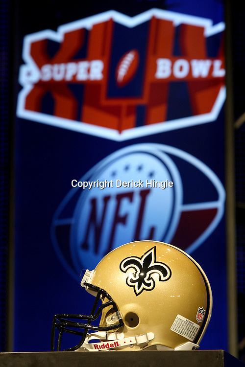 Feb 05, 2010;  Fort Lauderdale, FL, USA; The New Orleans Saints team helmet on display at the Super Bowl XLIV media center at the Fort Lauderdale/Broward County Convention Center. Mandatory Credit: Derick E. Hingle
